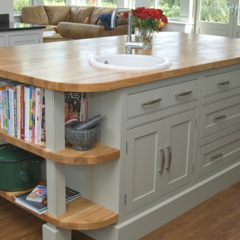 large kitchen island with oak worktop and prep sink