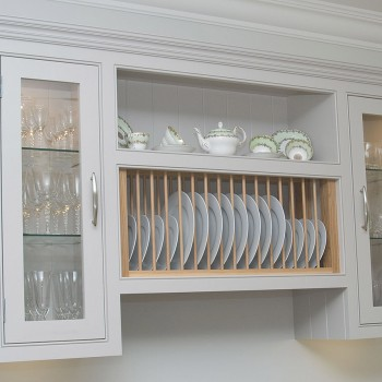 wall unit with glazed doors and plate rack