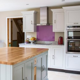 shaker kitchen with coloured glass splashback