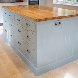 large kitchen island with oak worktop